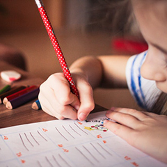 Child writing or drawing on paper