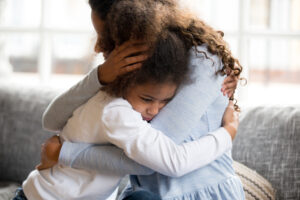 Mother embrace little preschool frustrated kid