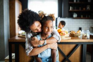 Happy mother and children in kitchen.